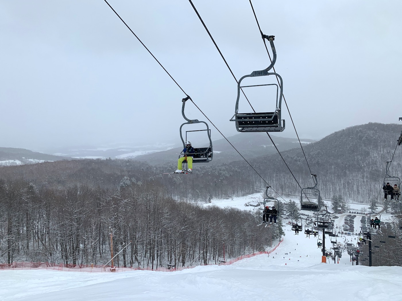 two chairlifts side by side